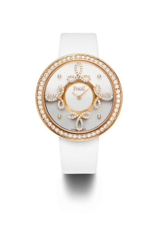 Limelight Dancing Light en oro rosa engastado en 206 diamantes corte brillante. Carátula blanca, correa de satén blanco. Movimiento cuarzo Piaget 56P.