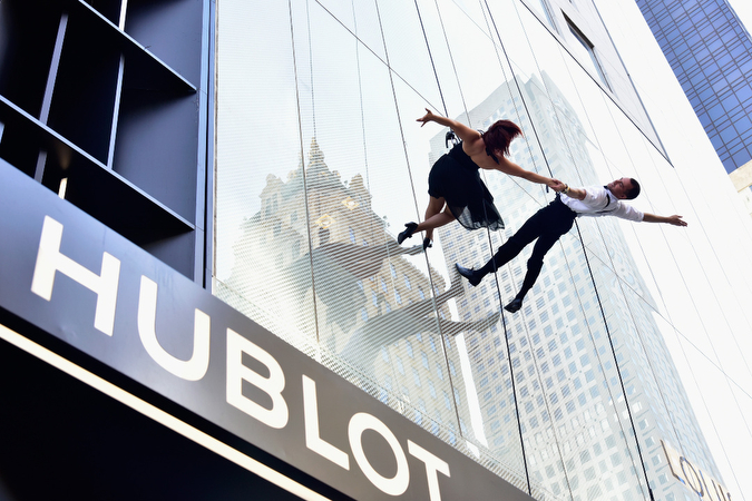 """NEW YORK, NY - APRIL 19: Dancers rappel down the facade of the Hublot Fifth Avenue Boutique during Hublot's celebration of the grand opening of it's Fifth Avenue Boutique in NYC on April 19, 2016 in New York City. (Photo by Eugene Gologursky/Getty Images for Hublot)"""